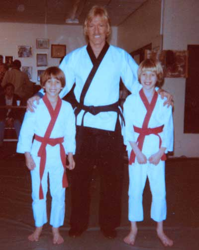 Chuck Norris with brothers James (left) and John Lechago (right)